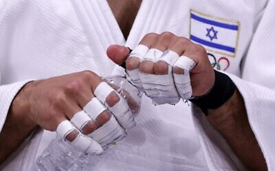 Israel's Tohar Butbul gets ready to compete in the judo men's -73kg elimination round bout during the Tokyo 2020 Olympic Games at the Nippon Budokan in Tokyo on July 26, 2021. (Jack GUEZ / AFP)