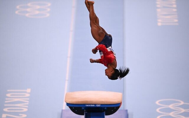 US's Simone Biles competes in the vault event of the artistic gymnastics women's team final during the Tokyo 2020 Olympic Games at the Ariake Gymnastics Centre in Tokyo on July 27, 2021. (Martin BUREAU / AFP)