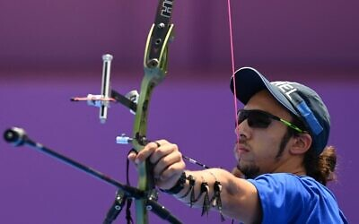 Israeli archer Itay Shanny competes in the men's individual eliminations during the Tokyo 2020 Olympic Games at Yumenoshima Park Archery Field in Tokyo on July 28, 2021. (Photo by ADEK BERRY / AFP)