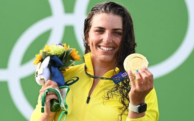 Australia's Jessica Fox poses with her gold medal on the podium following the women's Canoe final during the Tokyo 2020 Olympic Games at Kasai Canoe Slalom Centre in Tokyo on July 29, 2021. (Photo by Charly TRIBALLEAU / AFP)