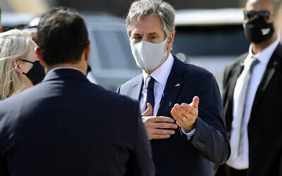 US Secretary of State Antony Blinken (C) speaks with officials before he boards his plane on his return to the United States from Kuwait International Airport in Kuwait City, on July 29, 2021. (Jonathan Ernst/Pool/ AFP)