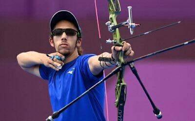 Israel's Itay Shanny competes in the men's individual eliminations during the Tokyo 2020 Olympic Games at Yumenoshima Park Archery Field in Tokyo on July 31, 2021. (ADEK BERRY / AFP)