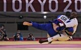 France's Teddy Riner (white) and Israel's Or Sasson compete in the judo mixed team's quarterfinal bout during the Tokyo 2020 Olympic Games at the Nippon Budokan in Tokyo on July 31, 2021. (Jack GUEZ / AFP)