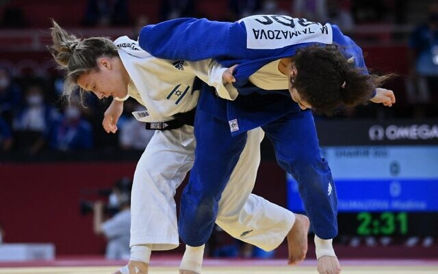 Russia's Madina Taimazova (blue) and Israel's Gili Sharir compete in the judo mixed team's bronze medal B bout during the Tokyo 2020 Olympic Games at the Nippon Budokan in Tokyo, on July 31, 2021. (Franck Fife/AFP)