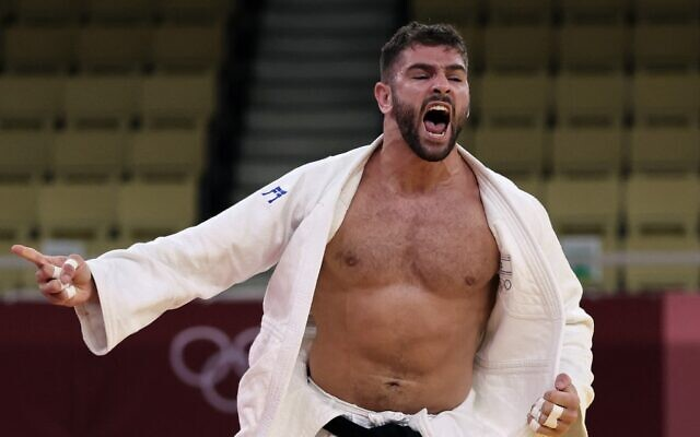 Israel's Peter Paltchik celebrates his victory over Russia's Tamerlan Bashaev in the judo mixed team's bronze medal B bout during the Tokyo 2020 Olympic Games at the Nippon Budokan in Tokyo, on July 31, 2021. (Jack Guez/AFP)