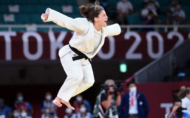 Israel's Timna Nelson Levy celebrates winning the decisive bout in the judo mixed team's bronze medal B match against Russia during the Tokyo 2020 Olympic Games at the Nippon Budokan in Tokyo, on July 31, 2021. (Franck Fife/AFP)