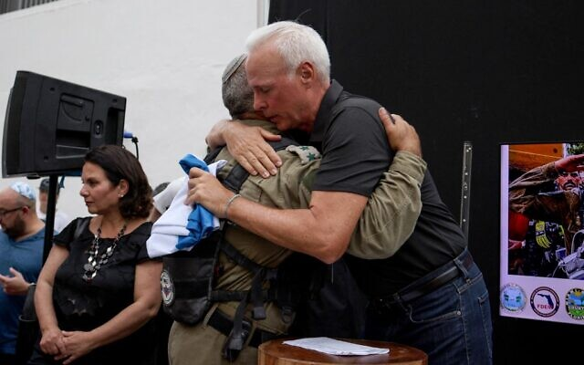 Surfside Mayor Charles Burkett (R) hugs Golan Vach, Commander of Israel Defense Forces'National Rescue Unit (L) at a send-off for the Israeli Unit on July 10, 2021 in Surfside, Florida.(Anna Moneymaker / GETTY IMAGES NORTH AMERICA / Getty Images via AFP)
