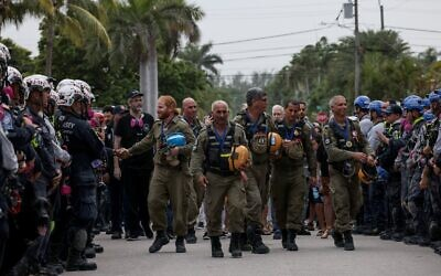 Members of the Israel Defense Forces National Rescue Unit are given a send off by search and rescue personnel July 10, 2021 in Surfside, Florida (Anna Moneymaker/Getty Images/AFP)