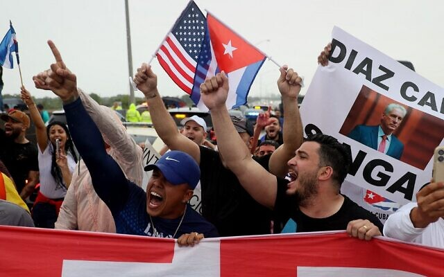 Protesters shut down part of the Palmetto Expressway as they show their support for anti-government protesters in Cuba, on July 13, 2021, in Miami, Florida. (Joe Raedle/Getty Images/AFP)