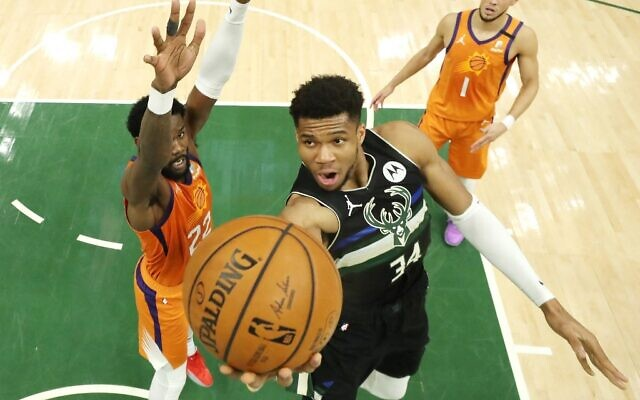 Giannis Antetokounmpo of the Milwaukee Bucks goes up for a shot against Deandre Ayton of the Phoenix Suns during the second half in Game Six of the NBA Finals at Fiserv Forum on July 20, 2021 in Milwaukee, Wisconsin. (JONATHAN DANIEL / GETTY IMAGES NORTH AMERICA / Getty Images via AFP)