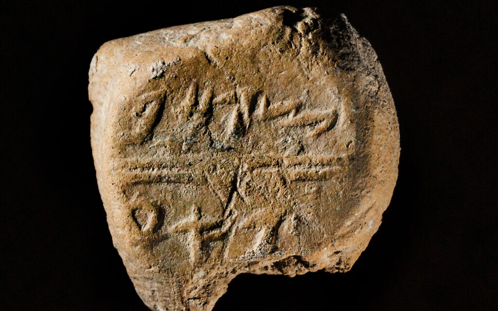 This stamp seal was found among other objects in a building near the remains of the First Temple-era wall protecting Jerusalem's eastern side. It bears the name Tsafan in ancient Hebrew script. (Koby Harati/ City of David)