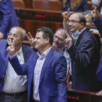 Joint List MKs celebrate after a Knesset vote rejected an extension of the Palestinian family reunification law, in Jerusalem, July 6, 2021. (Yonatan Sindel/Flash90)