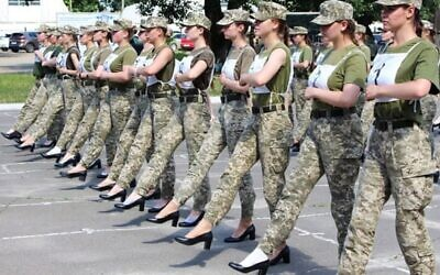 Handout photo shows Ukrainian female soldiers marching in heels during a recent parade rehearsal in Kyiv. (Ukraine Defense Ministry)