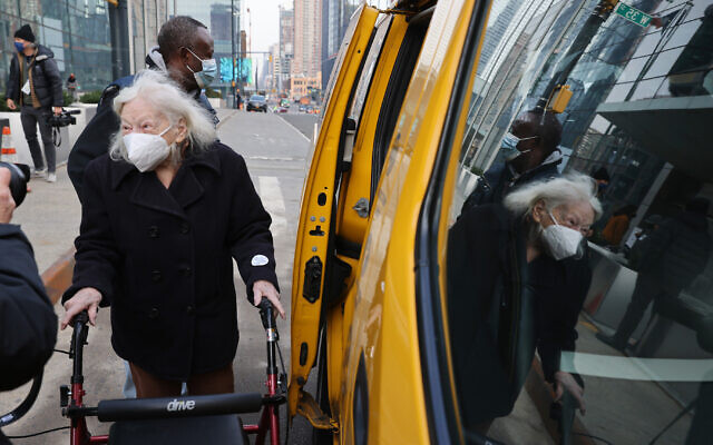 Muriel Mandel leaves the Javits Center in New York City after becoming one of the first people to receive the COVID-19 shot at the mass vaccination site, January 13, 2021. (Spencer Platt/Getty Images/ via JTA)