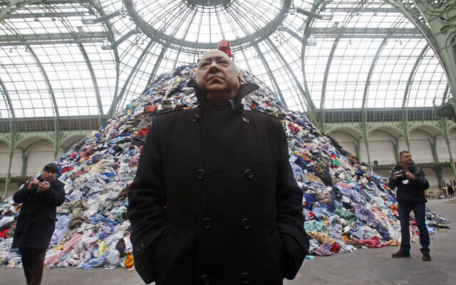 French artist Christian Boltanski stands next to his installation 'Persones' during the Monumenta 2010 exhibition at the Grand Palais in Paris, January 12, 2010.(AP Photo/Michel Euler)
