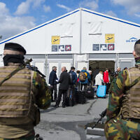 illustrative: Soldiers patrol as passengers arrive at a temporarily check in a terminal at Brussels Airport, in Zaventem, Belgium, Monday, April 4, 2016.  (AP Photo/Laurie Dieffembach, Pool)