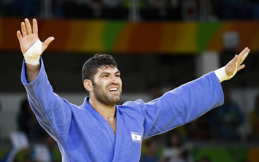 Israel's Or Sasson celebrates after winning the bronze medal during the men's over 100-kg judo competition at the 2016 Summer Olympics in Rio de Janeiro, Brazil, Friday, Aug. 12, 2016. (AP Photo/Markus Schreiber)