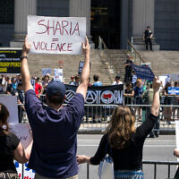 Demonstrators gathered to protest against Islamic law, foreground, stand across from counter demonstrators Saturday, June 10, 2017, in New York. (AP/Craig Ruttle)