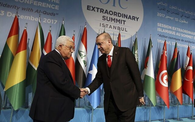 In this December 13, 2017 file photo, Turkey's President Recep Tayyip Erdogan shakes hands with Palestinian Authority President Mahmoud Abbas at the Organization of Islamic Cooperation's Extraordinary Summit in Istanbul. (Yasin Bulbul/Pool Photo via AP)