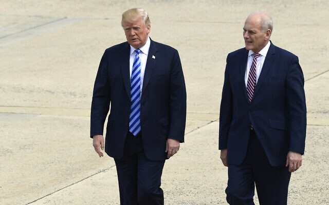 Then-US president Donald Trump and White House chief of staff John Kelly walk toward Air Force One at Andrews Air Force Base in Maryland, May 4, 2018. (AP Photo/Susan Walsh)