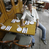 """FILE- In this Aug. 8, 2007 file photo, Anthony Bourdain, host of theTravel Channel's """"No Reservations,"""" poses in a New York restaurant. Court papers show Bourdain was worth $1.2 million when he died in June 2018. Most of his estate was left to his 11-year-old daughter. (AP Photo/Mary Altaffer, File)"""