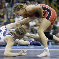 Helen Maroulis, right, controls Katherine Fulp-Allen during their 53-kilogram women's match at the US Olympic Wrestling Team Trials in Iowa City, Iowa, April 10, 2016, (AP Photo/Charlie Neibergall, File)