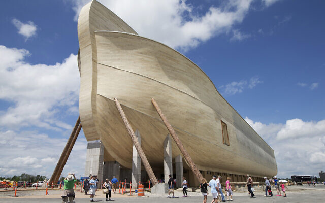 Visitors pass outside the front of a replica Noah's Ark at the Ark Encounter theme park during a media preview day, in Williamstown, Kentucky, July 5, 2016. (AP Photo/John Minchillo, File)