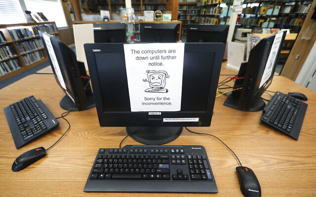 Illustrative: An Aug. 22, 2019 file photo shows signs on a bank of computers telling visitors that the machines are not working at the public library in Wilmer, Texas. (AP/Tony Gutierrez)