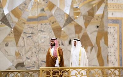 Saudi Crown Prince Mohammed bin Salman, left, attends a ceremony with Abu Dhabi Crown Prince Mohammed bin Zayed Al Nahyan at Qasr Al Watan in Abu Dhabi, United Arab Emirates, November 27, 2019. (Mohamed Al Hammadi/Ministry of Presidential Affairs via AP)