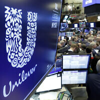In this March 15, 2018, photo, the logo for Unilever appears above a trading post on the floor of the New York Stock Exchange. (AP Photo/Richard Drew, file)