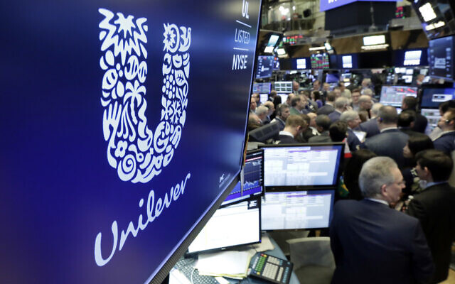 In this Thursday, March 15, 2018 file photo, the logo for Unilever appears above a trading post on the floor of the New York Stock Exchange. (AP Photo/Richard Drew, file)