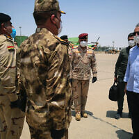 Iraq's Prime Minister Mustafa al-Kadhimi, right, arrives in Basra, Iraq, July 15, 2020. (Ahmed al-Rubaye/Pool Photo via AP)