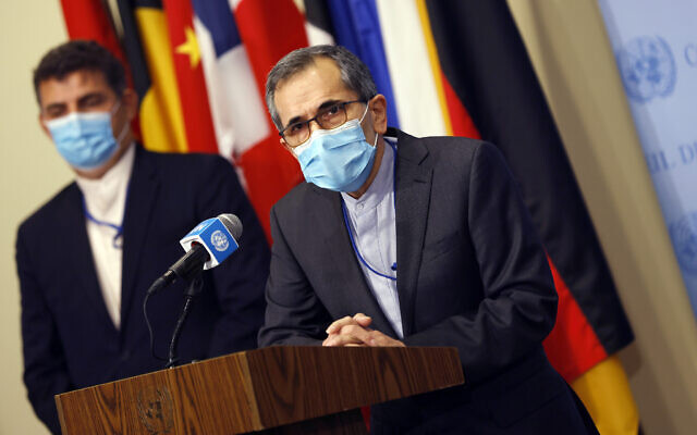 Iran's UN Ambassador Majid Takht Ravanchi speaks to reporters following a meeting with members of the UN Security Council, August 20, 2020, at the United Nations. (Mike Segar/Pool via AP)