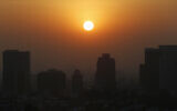 The sun rises amid smog during the dry season in Mexico City, February 20, 2020. (AP Photo/Marco Ugarte)