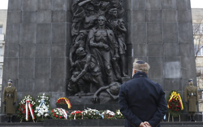 A wreath is laid at the monument to the Heroes of the Warsaw Ghetto in Warsaw, Poland, on Wednesday, on January 27, 2021, to recognize Holocaust victims. (AP Photo/Czarek Sokolowski)