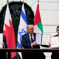 In this September 15, 2020, file photo, from left; former Israeli prime minister Benjamin Netanyahu, former US president Donald Trump, and United Arab Emirates Foreign Minister Abdullah bin Zayed al-Nahyan, sit during the Abraham Accords signing ceremony on the South Lawn of the White House, in Washington. (AP Photo/Alex Brandon, File)