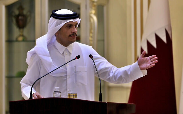 Qatari Foreign Minister Sheikh Mohammed bin Abdulrahman Al Thani speaks during a joint press conference with his Iraqi counterpart Mohamed Alhahkim in Baghdad, Iraq, on March 24, 2021. (AP Photo/Khalid Mohammed)