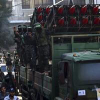 Masked Hamas members parade with Qassam rockets through the streets of Khan Younis, southern Gaza Strip, May 27, 2021. (AP/Yousef Masoud)