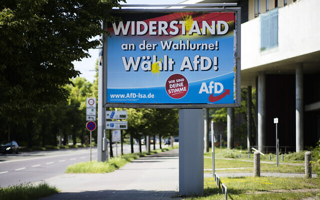 An election campaign poster of the far-right Alternative for Germany, AfD, party stands near a road in the federal state Saxony-Anhalt's capital in Magdeburg, Germany, on June 2, 2021. (AP Photo/Markus Schreiber)