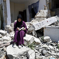 A woman outside her family's house in Rafah refugee camp, southern Gaza Strip, June 15, 2021. (Adel Hana/AP)