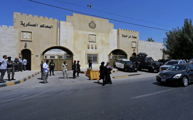 Security forces stand outside the state security court where the trial of Bassem Awadallah, a former royal adviser, and  Sharif Hassan bin Zaid, a distant cousin of the king, is taking place, in Amman, Jordan, on June 21, 2021. (Raad Adayleh/AP)