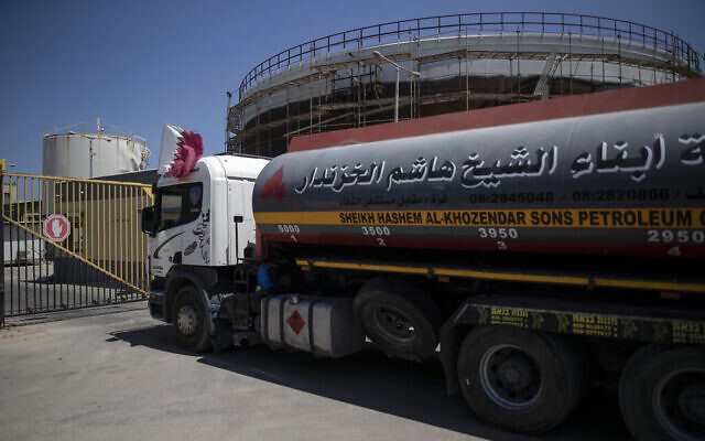A fuel truck with a Qatari flag enters the Nusseirat power plant, in the central Gaza Strip, June 28, 2021. (AP Photo/Khalil Hamra)