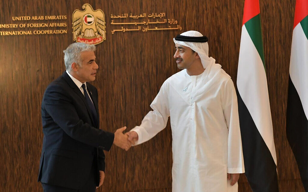 Foreign Minister Yair Lapid shakes hands with United Arab Emirates Foreign Minister Sheikh Abdullah bin Zayed al-Nahyanin Abu Dhabi, United Arab Emirates, Tuesday, June 29, 2021. (Shlomi Amsalem/Government Press Office via AP)