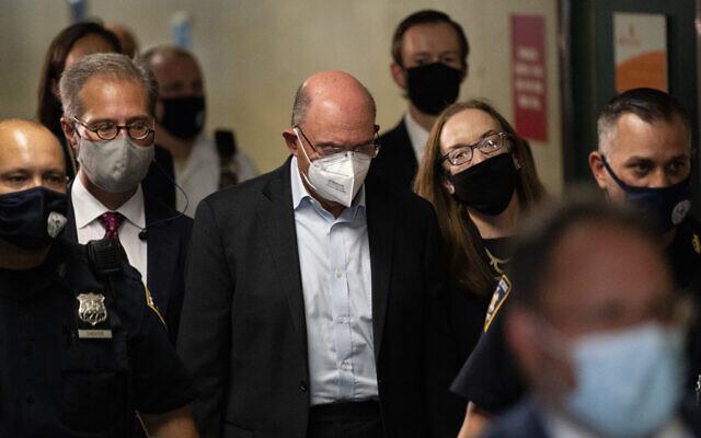 Allen Weisselberg, center, departs Manhattan criminal court, July 1, 2021, in New York. (AP Photo/John Minchillo)