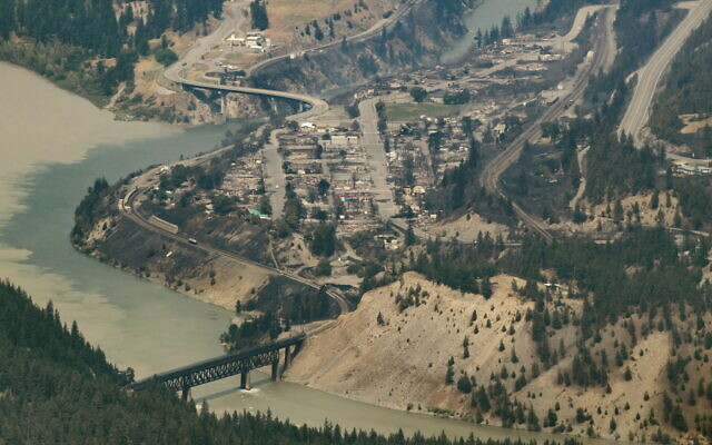 In this aerial photo taken from a helicopter, structures destroyed by a wildfire are seen in Lytton, British Columbia, on July 1, 2021. (Darryl Dyck/The Canadian Press via AP)
