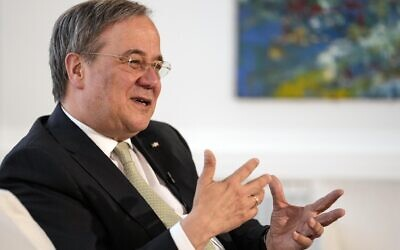 Governor of North Rhine-Westphalia Armin Laschet gestures during an interview with the Associated Press at his office in Duesseldorf, Germany, June 30, 2021. (AP Photo/Martin Meissner)