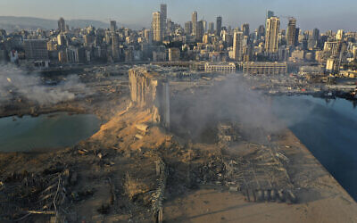 In this August 5, 2020 file photo, a drone picture shows the destruction after an explosion at the seaport of Beirut, Lebanon. (AP/Hussein Malla)
