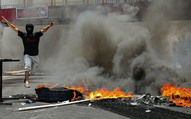 Protesters burn tires to block roads during a demonstration demanding the return of electricity in Basra, southeast of Baghdad, Iraq, July 2, 2021. (AP/Nabil al-Jurani)