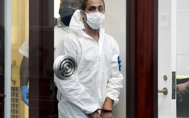 Khaled Awad is led into court while arraigned on charges in the stabbing of a rabbi near a Jewish day school, in Brighton District Court in Boston, Friday July 2, 2021. (Mary Schwalm/The Boston Herald via AP, Pool)