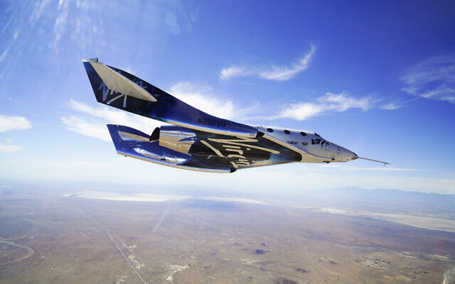 This May 29, 2018, photo made available by Virgin Galactic shows the company's VSS Unity on its second supersonic flight.  (Virgin Galactic via AP)